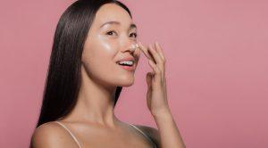 woman putting moisturizer cream