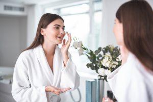 women applying face cream